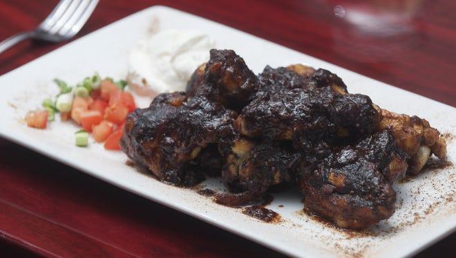 A Voodoo wings dish pairs well with a Double Nickel brew at The Riverpark Pub in Gloucester City.