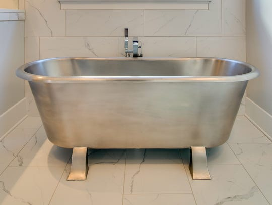 The Signature Hardware stainless steel tub in Carbine's