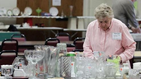 Jane Paul of Sheboygan Falls, checks over items last year during the annual St. Paul Friends Club Trash & Treasure rummage sale at St. Paul Lutheran Church in Sheboygan Falls, which happens Saturday.