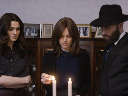 "(From left) Rachel Weisz as Ronit Krushka, Rachel McAdams as Esti Kuperman and Alessandro Nivola as Dovid Kuperman in ""Disobedience."""