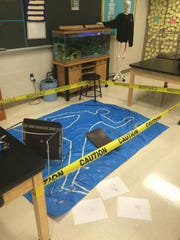 Students had to make detailed observations of the scene of the crime, and find clues that would help them identify the murderer and cause of death of John Doe.