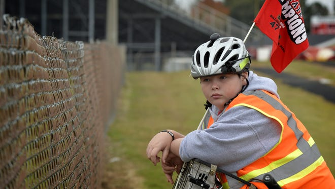 Since the start of the 2014 season, Simpsonville eighth-grader Andrew Pepper, above, and his father have biked to all but two Hillcrest football games.