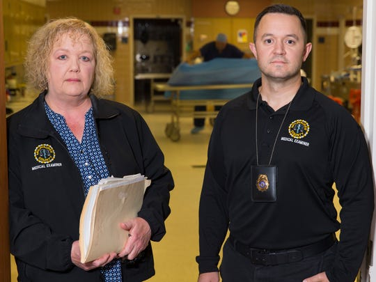 Milwaukee County medical examiner's office investigators Jenni Penn (left) and Michael Simley  helped track down the identity of David Conner, whose body was found in the Milwaukee River in 1975.