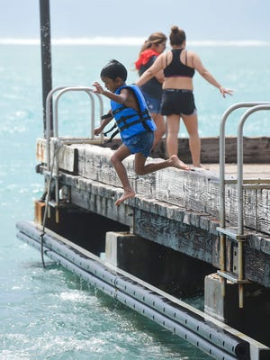 Alex Cruz, 5, takes a jump off the Merizo Pier during a family day on Oct. 22, 2017.