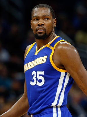 Kevin Durant looks back against the Orlando Magic during the second half at Amway Center.
