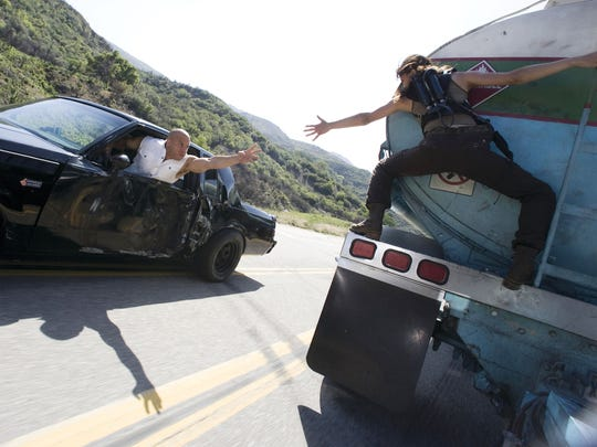 """Dom (Vin Diesel) tries to rescue main squeeze Letty (Michelle Rodriguez) in """"Fast & Furious."""""""
