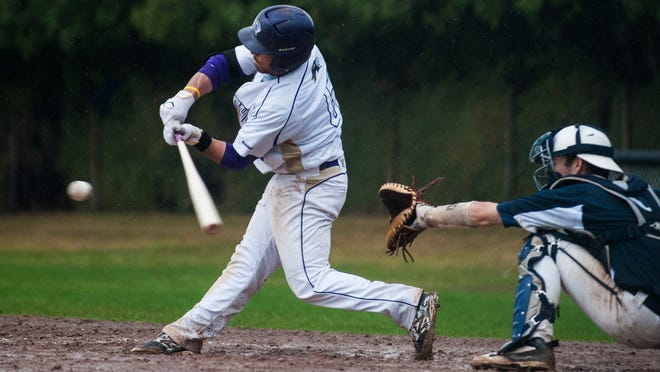 St. Mike's Michael Dougherty (6) hits the ball during the men's baseball game between the St. Anselm Hawks and the St. Michael's Purple Knights at Doc Jacobs Field last week in Colchester.