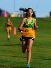 CMR's Mackenzie George cruises to a first-place finish during the crosstown cross country meet in 2014.