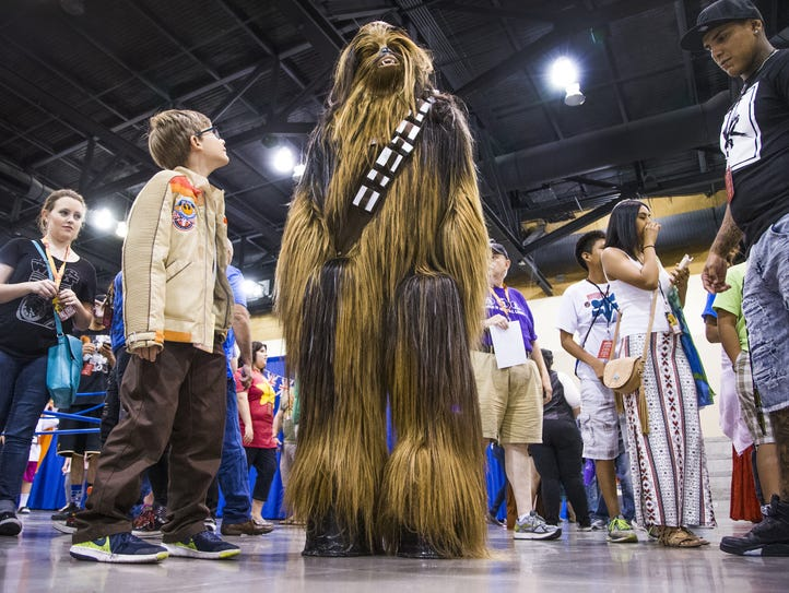 A very tall Chewbacca from Star Wars hangs out at Phoenix