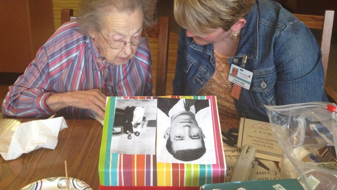 Bereavement coordinator Linda Wein, right, assists Marion Karstedt, Harvest Home of Howards Grove resident, in creating a memory box.