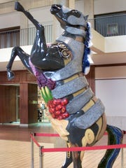 """Old Rochester,"" seen here on display inside Midtown Plaza in 2001, was created by artist Cynthia Nado."
