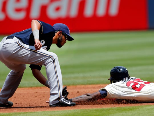 Atlanta Braves' Cameron Maybin is tagged out at second base by Milwaukee Brewers shortstop Luis Sardinas while attempting to steal Sunday in Atlanta.