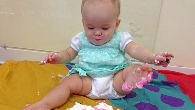 Isabella was a mess after eating her smash cake during her birthday party at Gymboree on Saturday.