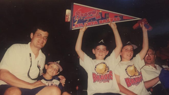 The Raimondo family of Brockport at an Atlanta Braves game in 2000 — the first game in their 15-year tour of all Major League Baseball stadiums. From left, Dan Raimondo, Pete Raimondo, Mike Raimondo and Joe Raimondo.