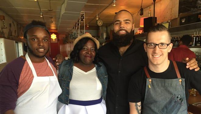 From left, scholarship winner Brandon Johnson, his mother Hopi Johnson, Lions linebacker DeAndre Levy and chef James Rigato pose at Mabel Gray restaurant.