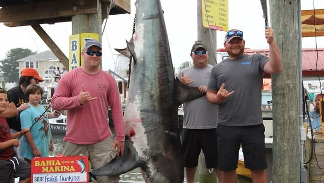 Nick Skidmore and members of the Fishful Thinking pose with a 644.9-pound shark at Mako Mania on June 2.
