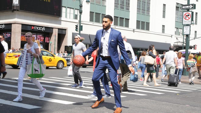 Denzel Valentine dribbles on the streets of New York during a promotion video for Macy's ahead of Thursday's NBA Draft. It was his first endorsement contract.