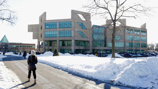 This Feb. 7, 2014 file photo shows a student walking on the campus of Chicago State University in Chicago.