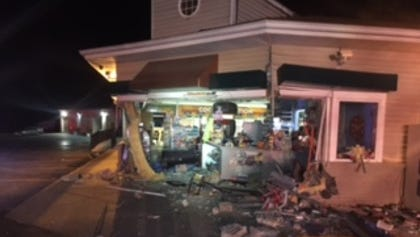 A vehicle crashed into the front of the Marathon gas station in the village of Dimondale.  The vehicle continued through the gas station and continued onto East Road where it hit a telephone pole, and caught on fire.