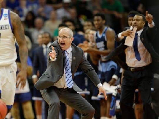 Rhode Island head coach Dan Hurley instructs his players to get back on defense during the second half against Creighton in a first-round game of the men's NCAA college basketball tournament Sacramento, Calif., Friday, March 17, 2017. Rhode Island won 84-72.