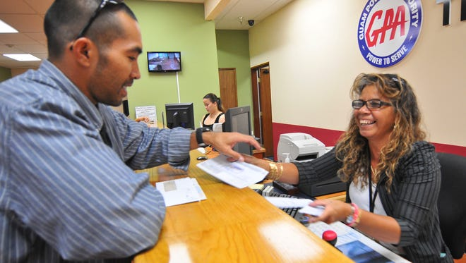 A customer pays at the Guam Power Authority customer service office.