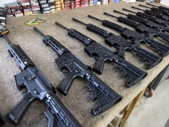 Newly assembled AR-15s fill some workbench space in