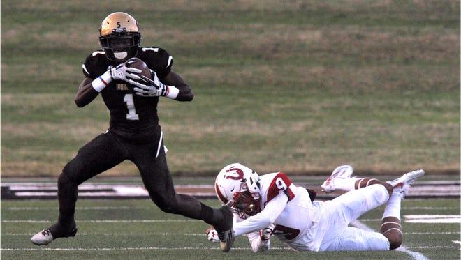 Abilene High School wide receiver Raekwon Millsap outruns Broncho defensive back Aaron Ochoa during the Eagles' game against Odessa High School Thursday Sept. 21, 2017. Abilene High won, 31-21.
