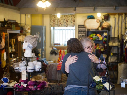 """Sonya Addington, right, and Penny Kroeger embrace upon hearing some excellent news at the City Stitch Yarn Shop at 115 E. Locust Street in Boonville, Ind., Tuesday morning. """"So have you read Facebook yet this morning?"""" Addington, the owner of the shop, asked. """"We're cancer free. We found out this morning that when they did his last surgery, no margins, no chemo, no radiation, no nothing. It's a wonderful thing."""" The shop owner's husband had been diagnosed with cancer recently."""