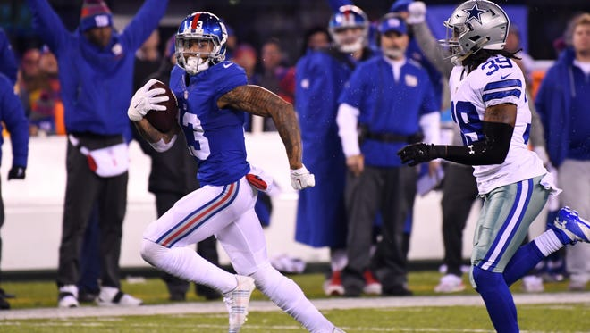 New York Giants wide receiver Odell Beckham (13) scores the game winning TD in the second half against the Dallas Cowboys at MetLife Stadium.