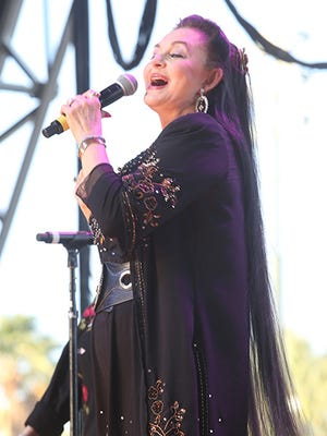 Crystal Gayle performs on the Palomino Stage at the Stagecoach Country Music Festival , Saturday, April 26, 2014.
