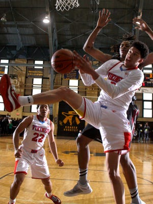 Everett's Trevor Manuel grabs a rebound in front of Muskegon's Deyonta Davis during Tuesday's Class A quarterfinal at Don Johnson Fieldhouse.