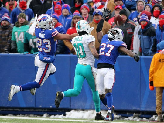 Bills Micah Hyde (23) and Tre'Davious White (27) defend