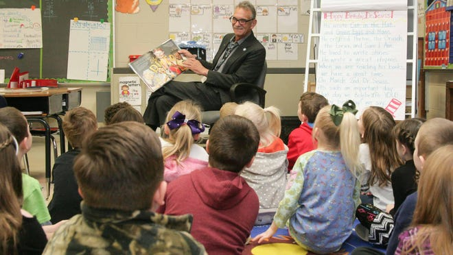White House Mayor Mike Arnold reads to students at Robert F. Woodall Elementary School last week as part of Read Across America.