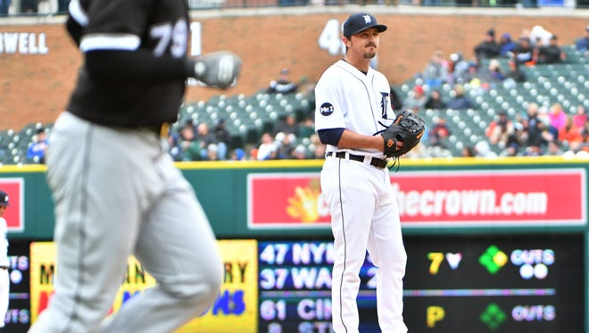 Tigers pitcher Blaine Hardy stands on the mound while White Sox' Jose Abreu rounds the bases on his solo home run in the eighth inning.