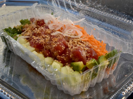 A tuna poke bowl is ready to be served during lunch at Big Fish Poke in Thousand Oaks on Tuesday