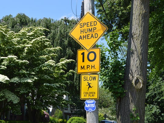 Signs posted on Holly Drive in New Rochelle for a temporary