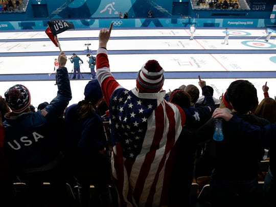 A fan wearing the American flag cheers during the men's curling semifinal between Team USA and Canada at the 2018 Winter Olympics in Gangneung, South Korea on Feb. 22, 2018.