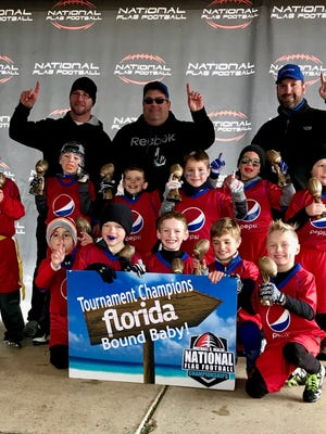 A second-grade flag football team from Howell will compete in a national tournament this weekend in Florida. The team is comprised of (front row, left to right)  Jackson Duppong, Logan Peevy, Joseph Parrelly, Brogan Forney and Landon Banfield, (middle row, left to right) Jack Gondick, Colin Wilson, Jack Hammond, Tripp Hamilton, Jack Gruber, and Gavin Allen and (back row, left to right) coaches Craig Duppong, Dave Hammond and Brent Gruber.