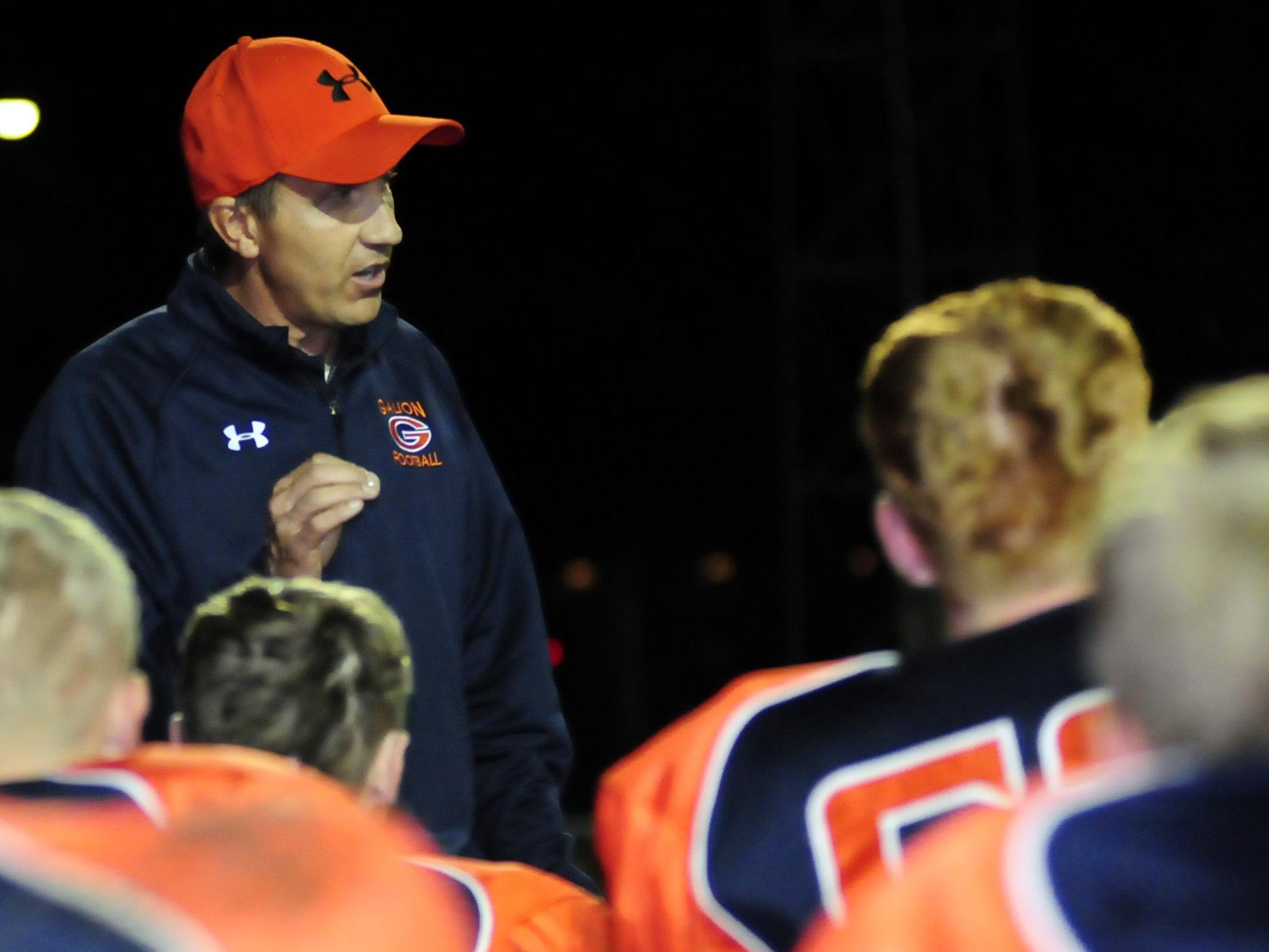 Galion coach Chris Hawkins talks to his team after a 50-35 win in 2013.