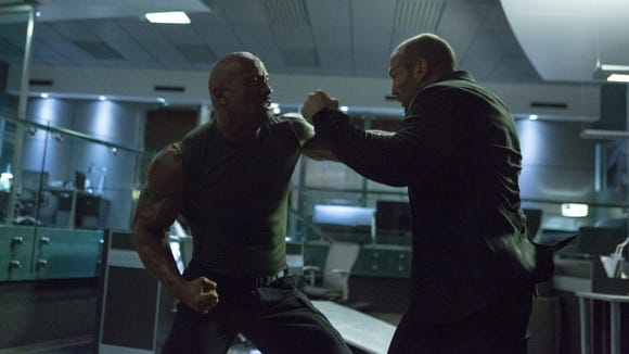 "Dwayne Johnson, left, and Jason Statham in a scene from ""Furious 7."""
