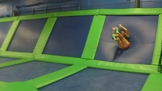 Michelle Mulak bounces off a trampoline wall at Airheads Trampoline Arena in Orlando.