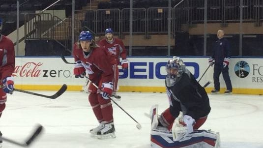 Rangers goalie Henrik Lundqvist, with Carl Hagelin in red, at the morning skate at Madison Square Garden Tuesday. It was the goalie's first practice since leaving the lineup with a vascular injury Feb. 2 He plans to play this weekend.