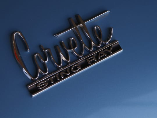 A Corvette Sting Ray logo on one of the cars at Russo