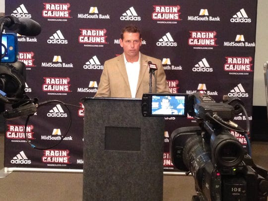 UL athletic director Bryan Maggard announces the termination of head football coach Mark Hudspeth at a news conference Sunday.