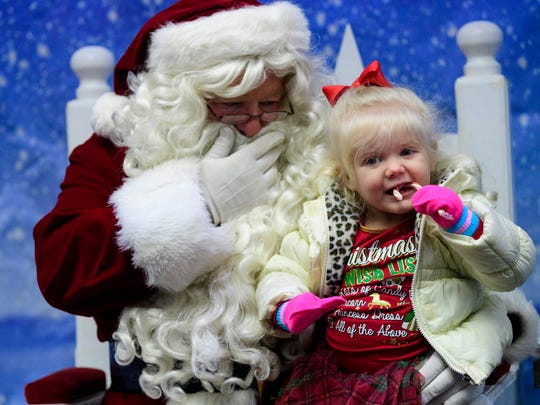 Watch Santa arrive by fire truck before he heads to Santa Land on Saturday.