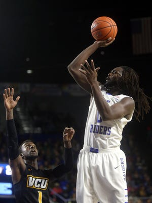 MTSU's Darnell Harris (0) goes up for a shot as VCW's Jequan Lewis (1) guards Harris during the MTSU home game on Wednesday, Dec. 2, 2015.