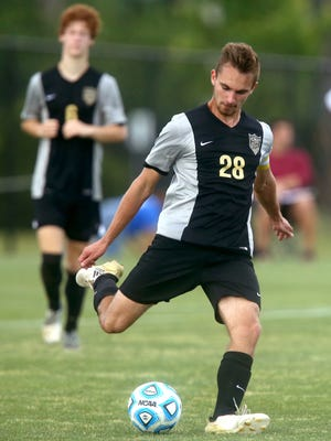 Central Magnet's Elijah Barritt passes the ball during Tuesday's A-AA state quarterfinal loss to CPA.