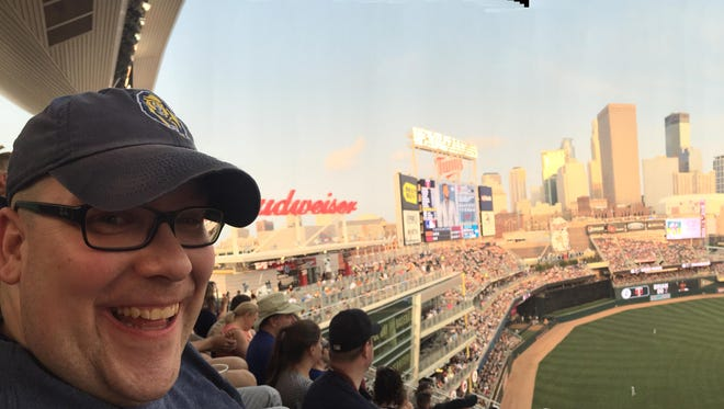 Beer columnist Will Cleveland enjoys the panoramic view at Target Field, home of the Minnesota Twins, in Minneapolis, Minnesota, last week with his all-time favorite beer in hand — Surly Furious IPA.