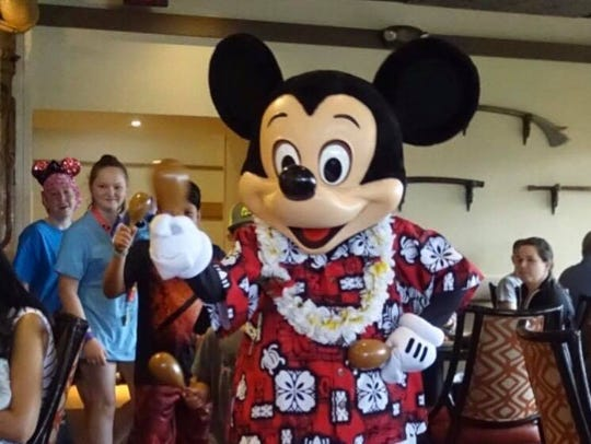 Mickey Mouse in the conga line at the 'Ohana restaurant