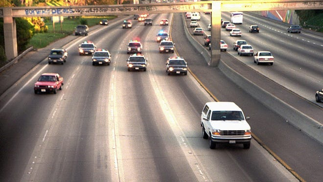 A white Ford Bronco, driven by Al Cowlings carrying O.J. Simpson, is trailed by Los Angeles police cars as it travels on a freeway in Los Angeles on June 17, 1994. Simpson's ex-wife, Nicole Brown Simpson, and her friend Ron Goldman were found stabbed to death outside her LA home. Simpson was later arrested after a widely televised freeway chase in the vehicle.